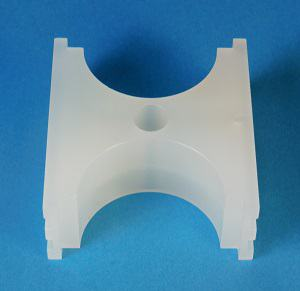 Cylindrical cement mold made of white polypropylene